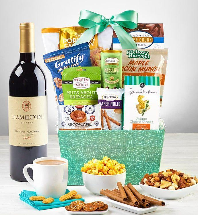 """<p><strong>1800 Baskets</strong></p><p>1800baskets.com</p><p><strong>$69.99</strong></p><p><a href=""""https://go.redirectingat.com?id=74968X1596630&url=https%3A%2F%2Fwww.1800baskets.com%2Fsnacks-and-sweets-gift-basket-with-wine-172086&sref=https%3A%2F%2Fwww.goodhousekeeping.com%2Fholidays%2Fgift-ideas%2Fg34054234%2Fbest-gift-baskets-for-women%2F"""" rel=""""nofollow noopener"""" target=""""_blank"""" data-ylk=""""slk:Shop Now"""" class=""""link rapid-noclick-resp"""">Shop Now</a></p><p>Pair your choice of wine (rosé or cabernet) with this assortment of sweet and savory snacks. There's popcorn, chocolate chunk cookies, chocolate wafer rolls, cheese straws, you get the idea.</p>"""