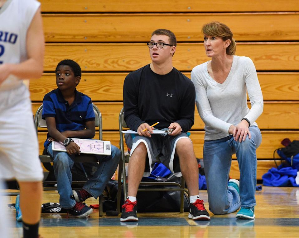 MT PLEASANT, SC - JANUARY, 25:  Debbie Antonelli keeps a close eye on the game with her son, Frankie Antonelli and Makia Brown, who are keeping stats during a scrimmage between the two Cario Middle School eighth grade boys teams on January 25, 2016 in Mt Pleasant, SC. (Jonathan Newton / The Washington Post via Getty Images)