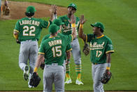 Oakland Athletics' Ramon Laureano (22), Seth Brown (15), Elvis Andrus (17) and Tony Kemp celebrate after the team's baseball game against the New York Yankees on Friday, June 18, 2021, in New York. The Athletics won 5-3. (AP Photo/Frank Franklin II)