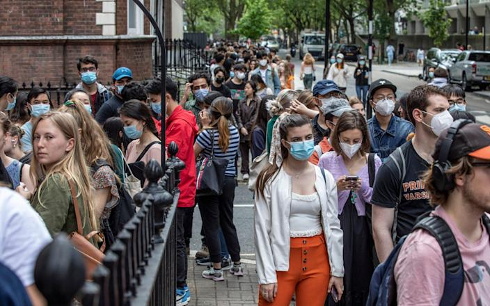 UCL Students queuing for a vaccine at Bloomsbury Surgery, London, on Saturday after the university opened a walk-in clinic to students - Jeff Gilbert