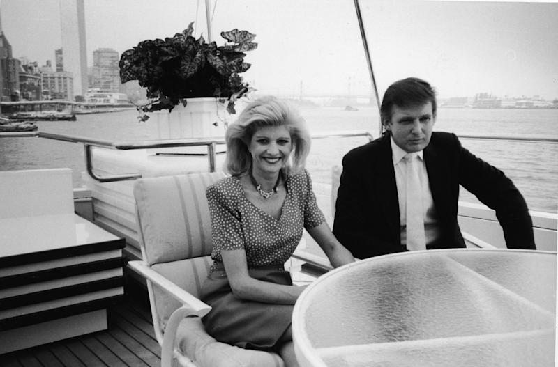 Ivana and Donald Trump sit at a table aboard their luxury yacht The Trump Princess, anchored outside the Water Club in New York in July 1988.