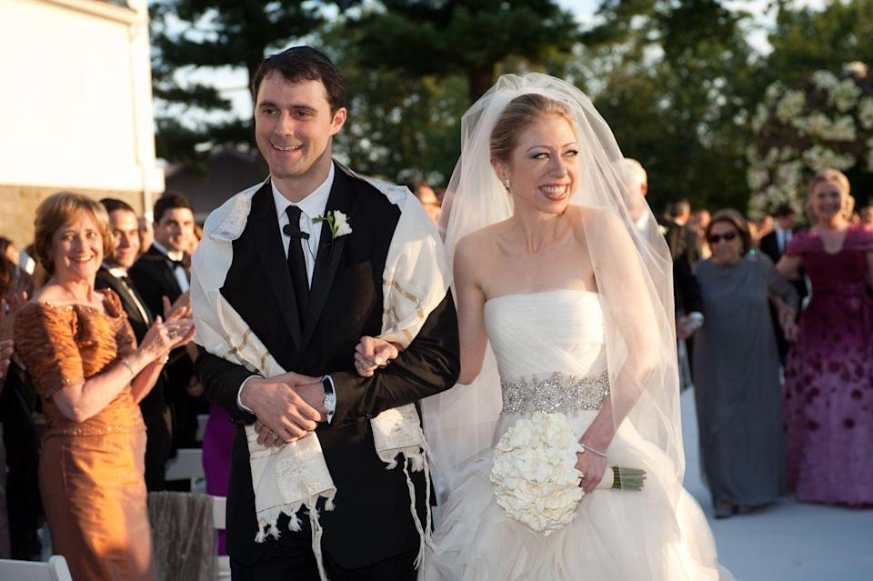 <p>America's former First Daughter, Chelsea Clinton, looks as happy as can be as she walks down the aisle with her husband, Marc Mezvinsky, following a ceremony in Rhinebeck, New York. </p>