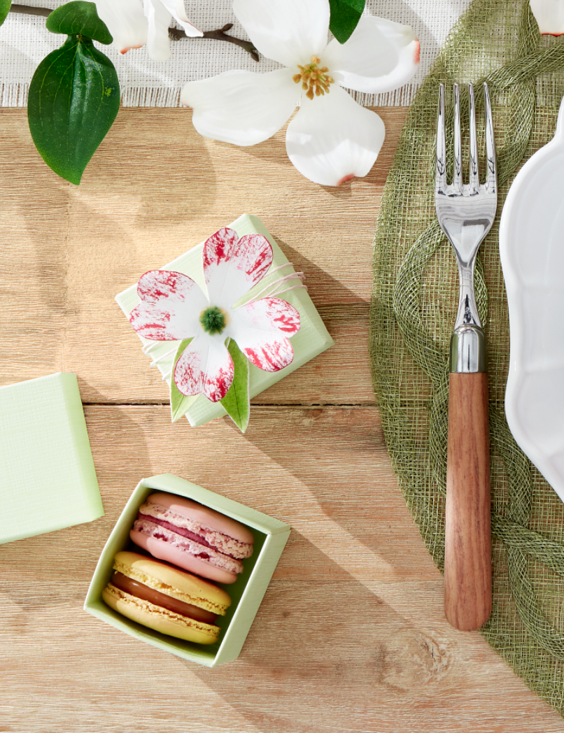 """<p>We love the look of these sweet floral boxes, which can be given as favors at the end of your Easter meal or used to welcome guests as it begins. Fill them with whatever homemade treat your heart desires!</p><p><strong>Make the Boxes: </strong>Top a small box with dogwood flowers cut from <a href=""""https://www.amazon.com/Zenacolor-Watercolour-Paper-Pad-Painting/dp/B07FNRKP4R?tag=syn-yahoo-20&ascsubtag=%5Bartid%7C10050.g.1111%5Bsrc%7Cyahoo-us"""" rel=""""nofollow noopener"""" target=""""_blank"""" data-ylk=""""slk:watercolor paper"""" class=""""link rapid-noclick-resp"""">watercolor paper</a> and decorated with watercolor pens. Hot-glue tiny pieces of green pipe cleaner to the centers, then cut leaves from green paper and hot-glue them to the bottoms of the flowers. Fill the boxes with macarons, wrap them with twine, and tape the flowers on top.</p><p><a class=""""link rapid-noclick-resp"""" href=""""https://www.amazon.com/UBRU-Watercolor-Painting-Non-Toxic-Calligraphy/dp/B0837LHD8V?tag=syn-yahoo-20&ascsubtag=%5Bartid%7C10050.g.1111%5Bsrc%7Cyahoo-us"""" rel=""""nofollow noopener"""" target=""""_blank"""" data-ylk=""""slk:SHOP WATERCOLOR PENS"""">SHOP WATERCOLOR PENS</a></p>"""