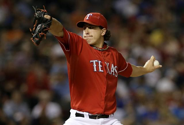 Texas Rangers starting pitcher Derek Holland works against the Houston Astros in the seventh inning of a baseball game, Monday, Sept. 23, 2013, in Arlington, Texas. Holland struck out nine in his second shutout of the season in the Rangers' 12-0 win. (AP Photo/Tony Gutierrez)