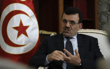 Tunisia's PM Larayedh speaks during an interview in Tunis