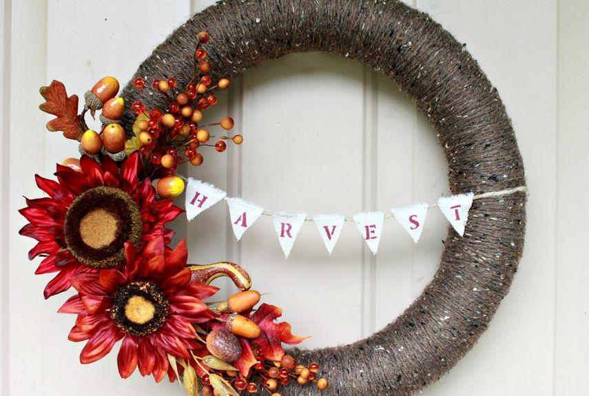 """<p>Vibrant colors + a bit of bunting = one sophisticated wreath. </p><p><strong>Get the tutorial at <a href=""""http://loveoffamilyandhome.net/2012/09/fall-wreath-with-harvest-bunting-pool.html"""" rel=""""nofollow noopener"""" target=""""_blank"""" data-ylk=""""slk:Love of Family and Home"""" class=""""link rapid-noclick-resp"""">Love of Family and Home</a>.</strong></p>"""