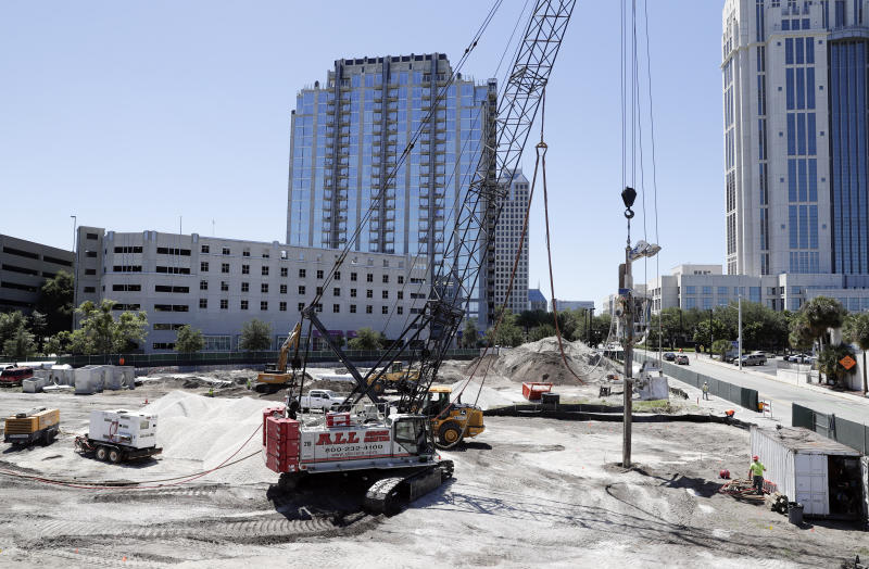 In this Tuesday, April 16, 2019, photo, construction begins on a new building in downtown Orlando, Fla. The U.S. Census Bureau said Thursday, April 18 that Orlando grew by 60,000 people from mid-2017 to mid-2018, making it the fifth biggest metro increase in pure numbers in the nation. (AP Photo/John Raoux)