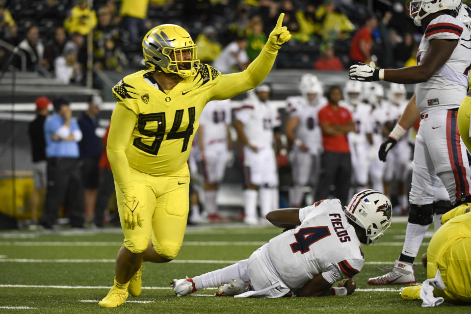 Oregon defensive tackle Sua'ava Poti (94) celebrates after sacking Stony Brook quarterback Tyquell Fields (4) during the third quarter of an NCAA college football game Saturday, Sept. 18, 2021, in Eugene, Ore. (AP Photo/Andy Nelson)
