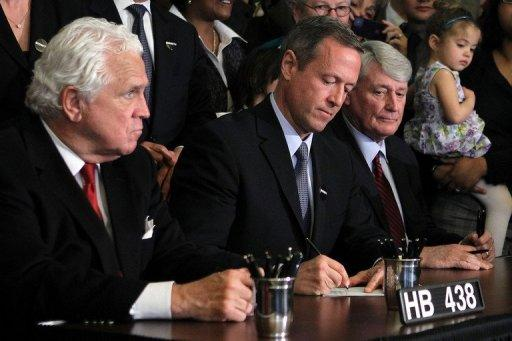 Maryland Gov. Martin O'Malley (C) signs the state's recently passed same-sex marriage bill into law