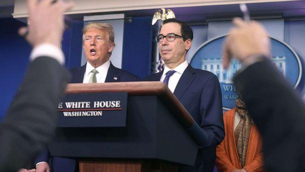 PHOTO: President Donald Trump and Treasury Secretary Steven Mnuchin answer questions during the daily coronavirus briefing at the White House, March 17, 2020. (Jonathan Ernst/Reuters)