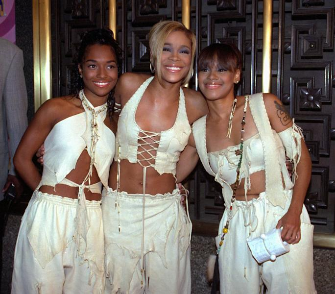 "FILE - In this Thursday, Sept. 7, 1995, file photo, the band TLC, left to right, Rozanda ""Chilli"" Thomas, Tionne ""T-Boz"" Watkins and Lisa ""Left Eye"" Lopes, pose for photographers outside New York's Radio City Music Hall before the start of the 12th Annual MTV Video Music Awards. TLC chronicles the Grammy-winning trio's rise to fame 'CrazySexyCool: The TLC Story' on VH1, which premieres on Monday, Oct. 21, 2013. (AP Photo/Adam Nadel, File)"