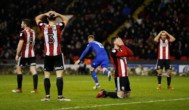 "Soccer Football - Championship - Sheffield United vs Cardiff City - Bramall Lane, Sheffield, Britain - April 2, 2018 Sheffield United players look dejected as Cardiff City's Anthony Pilkington celebrates scoring their first goal Action Images/Ed Sykes EDITORIAL USE ONLY. No use with unauthorized audio, video, data, fixture lists, club/league logos or ""live"" services. Online in-match use limited to 75 images, no video emulation. No use in betting, games or single club/league/player publications. Please contact your account representative for further details."