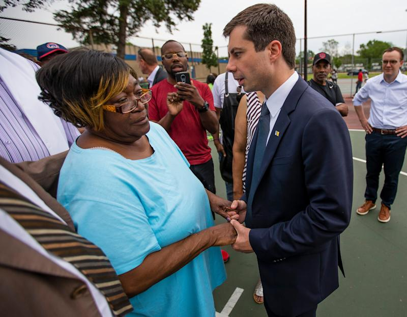 Pete Buttigieg shares a moment with Shirley Newbill during a gun violence memorial in South Bend, Indiana.