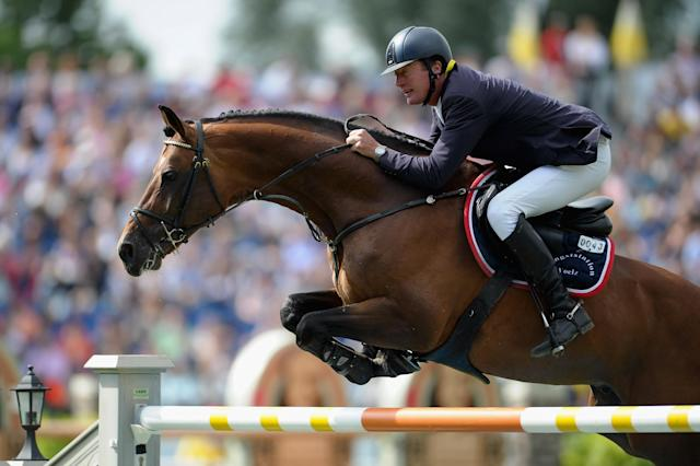 AACHEN, GERMANY - JULY 08: Thomas Voss of Germany and his horse Carinjo 9 compete in the Rolex Grand Prix jumping competition during day six of the 2012 CHIO Aachen tournament on July 8, 2012 in Aachen, Germany. (Photo by Dennis Grombkowski/Bongarts/Getty Images)