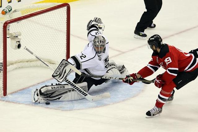 NEWARK, NJ - JUNE 09: Jonathan Quick #32 of the Los Angeles Kings makes a save in front of Travis Zajac #19 of the New Jersey Devils during Game Five of the 2012 NHL Stanley Cup Final at the Prudential Center on June 9, 2012 in Newark, New Jersey. (Photo by Jim McIsaac/Getty Images)