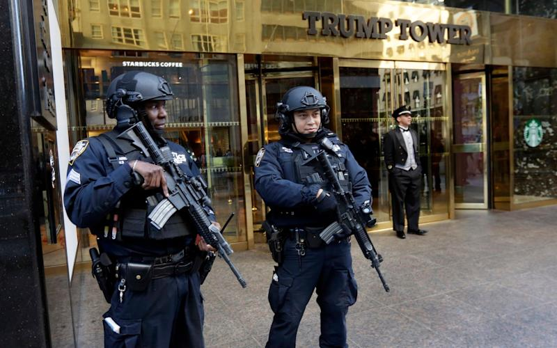 New York City Police officers guard the front of Trump Tower - AP