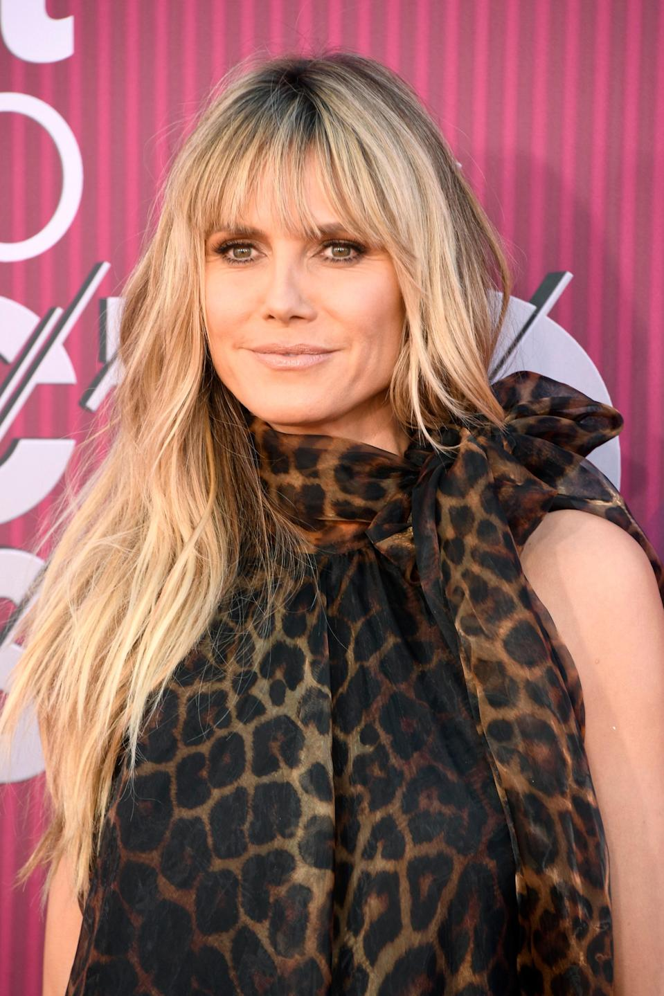 """""""If you have a square jawline, a long, layered fringe can help to soften and balance your features,"""" says Reyman. (They can also help thin hair look fuller.) If you're not into the straight-across look, he notes you can also opt for '70s-inspired <a href=""""https://www.glamour.com/story/curtain-bangs?mbid=synd_yahoo_rss"""" rel=""""nofollow noopener"""" target=""""_blank"""" data-ylk=""""slk:curtain bangs"""" class=""""link rapid-noclick-resp"""">curtain bangs</a>, which are a little more effortless to style."""