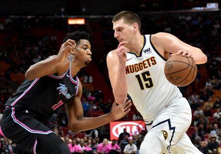 Jan 8, 2019; Miami, FL, USA; Denver Nuggets center Nikola Jokic (15) drives against Miami Heat center Hassan Whiteside (21) during the first half at American Airlines Arena. Mandatory Credit: Steve Mitchell-USA TODAY Sports