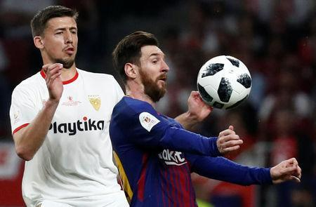 Soccer Football - Spanish King's Cup Final - FC Barcelona v Sevilla - Wanda Metropolitano, Madrid, Spain - April 21, 2018 Barcelona's Lionel Messi in action with Sevilla's Clement Lenglet REUTERS/Juan Medina