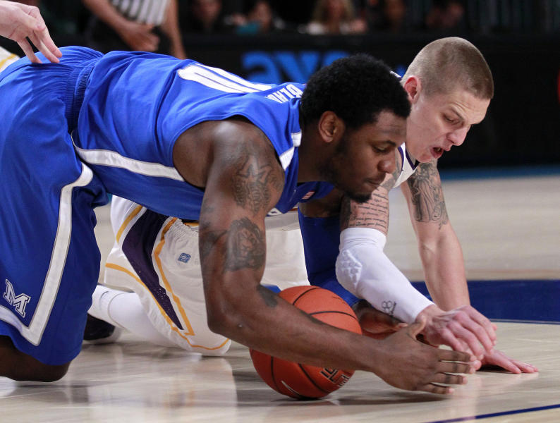 Memphis forward Tarik Black (10) and Northern Iowa guard Marc Sonnen (23) scramble for a loose ball during the first half of an NCAA college basketball game at the Battle 4 Atlantis tournament, Saturday, Nov. 24, 2012 in Paradise Island, Bahamas. (AP Photo/John Bazemore)