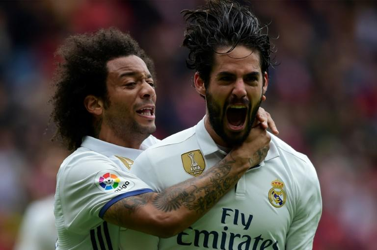 Real Madrid's Isco (R) is congratulated by Marcelo after scoring a goal during the Spanish league football match against Real Sporting de Gijon on April 15, 2017