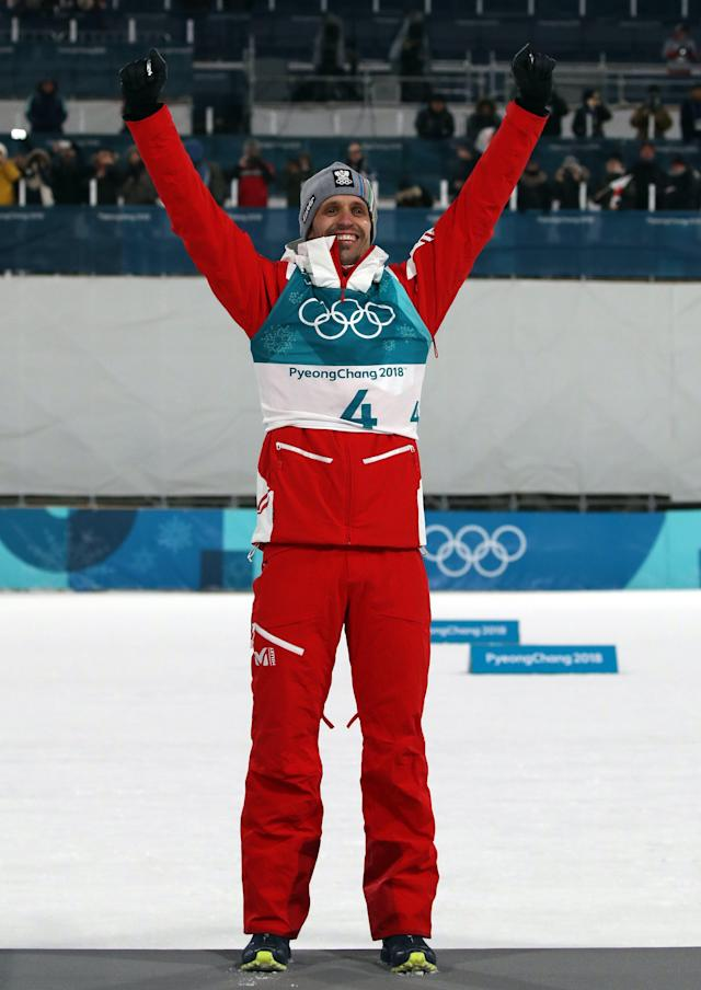 Nordic Combined Events – Pyeongchang 2018 Winter Olympics – Men's Individual 10km Final – Alpensia Cross-Country Skiing Centre - Pyeongchang, South Korea – February 14, 2018 - Bronze medalist Lukas Klapfer of Austria celebrates during the victory ceremony. REUTERS/Carlos Barria