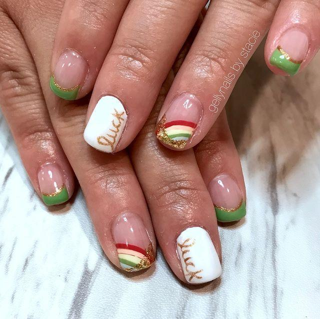 """<p>From the green french tips, to the """"luck"""" text, to the gold glitter waiting at the end of the mini rainbows, this is one of the most festive manicures you can wear this holiday.</p><p><a class=""""link rapid-noclick-resp"""" href=""""https://www.amazon.com/Makartt-Painting-Acrylic-Diamond-Handle/dp/B01EA3BB82/?tag=syn-yahoo-20&ascsubtag=%5Bartid%7C10055.g.26310821%5Bsrc%7Cyahoo-us"""" rel=""""nofollow noopener"""" target=""""_blank"""" data-ylk=""""slk:SHOP GOLD NAIL PEN"""">SHOP GOLD NAIL PEN</a></p><p><strong>RELATED:</strong> <a href=""""https://www.goodhousekeeping.com/holidays/g5020/st-patricks-day-games/"""" rel=""""nofollow noopener"""" target=""""_blank"""" data-ylk=""""slk:20 Fun St. Patrick's Day Games to Test Your Luck"""" class=""""link rapid-noclick-resp"""">20 Fun St. Patrick's Day Games to Test Your Luck</a></p><p><a href=""""https://www.instagram.com/p/BvHjLAkgS53/&hidecaption=true"""" rel=""""nofollow noopener"""" target=""""_blank"""" data-ylk=""""slk:See the original post on Instagram"""" class=""""link rapid-noclick-resp"""">See the original post on Instagram</a></p>"""
