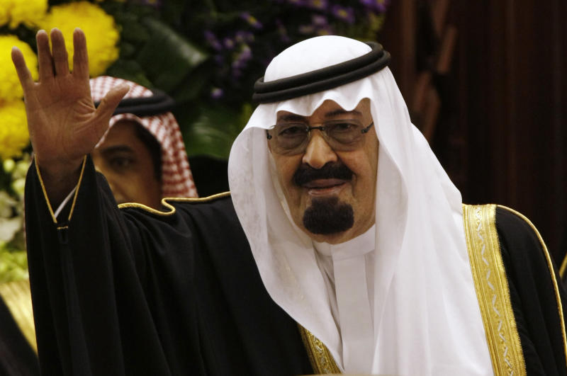 FILE - In this March 24, 2009 file photo, King Abdullah bin Abdul Aziz al-Saud of Saudi Arabia waves to members of the Saudi Shura Council in Riyadh, Saudi Arabia. King Abdullah granted women seats on the Shura Council, the country's top advisory council, for the first time on Friday, Jan. 11, 2013, giving them a long-awaited toehold in the ultraconservative kingdom's male-dominated political system. (AP Photo/Hassan Ammar, File)