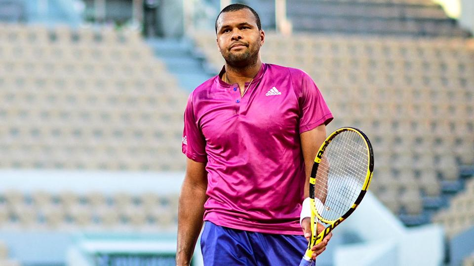 Pictured here, Jo-Wilfried Tsonga walks off after losing in the first round at the French Open.
