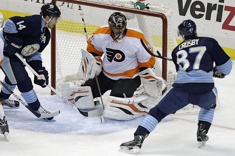 Pittsburgh Penguins center Sidney Crosby (87) and Pittsburgh Penguins left wing Chris Kunitz (14) can't get to a rebounding puck in front of Philadelphia Flyers goalie Ilya Bryzgalov (30) in the first period of an NHL hockey game in Pittsburgh Sunday, March 24, 2013. (AP Photo/Gene J. Puskar)