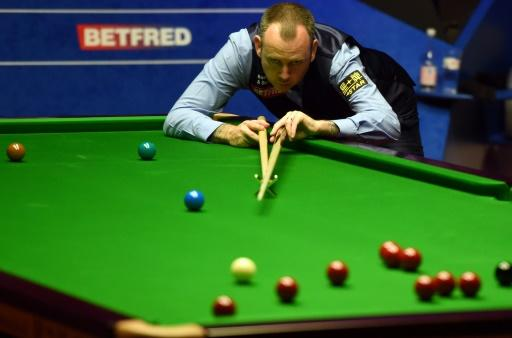 Mark Williams becomes world champion despite stunning Higgins recovery