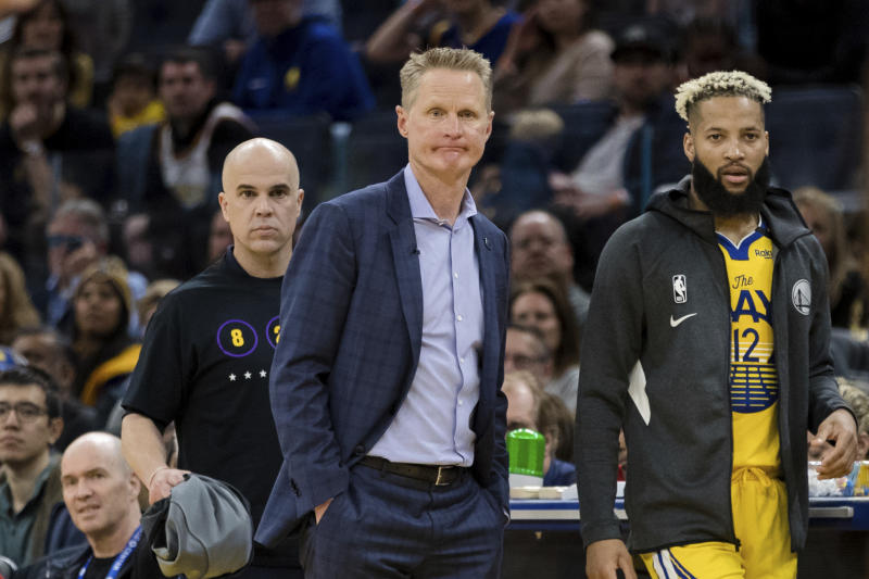 Steve Kerr on the sideline with a sad face.