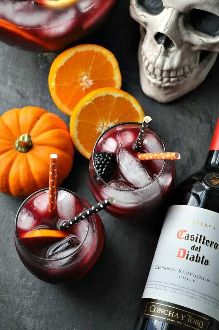 """<p>Celebrate Hallo-<em>wine</em> with this scary delicious sangria recipe you'll want to make every season.</p><p><strong>Get the recipe at <a href=""""https://www.theseasonedmom.com/hallowine-sangria/"""" rel=""""nofollow noopener"""" target=""""_blank"""" data-ylk=""""slk:The Seasoned Mom"""" class=""""link rapid-noclick-resp"""">The Seasoned Mom</a>. </strong></p><p><a class=""""link rapid-noclick-resp"""" href=""""https://go.redirectingat.com?id=74968X1596630&url=https%3A%2F%2Fwww.walmart.com%2Fip%2FMainstays-16-8-Ounce-Stemless-Wine-Glasses-Set-of-12%2F685995872&sref=https%3A%2F%2Fwww.thepioneerwoman.com%2Fholidays-celebrations%2Fg36792938%2Fhalloween-punch-recipes%2F"""" rel=""""nofollow noopener"""" target=""""_blank"""" data-ylk=""""slk:SHOP WINE GLASSES"""">SHOP WINE GLASSES </a></p>"""