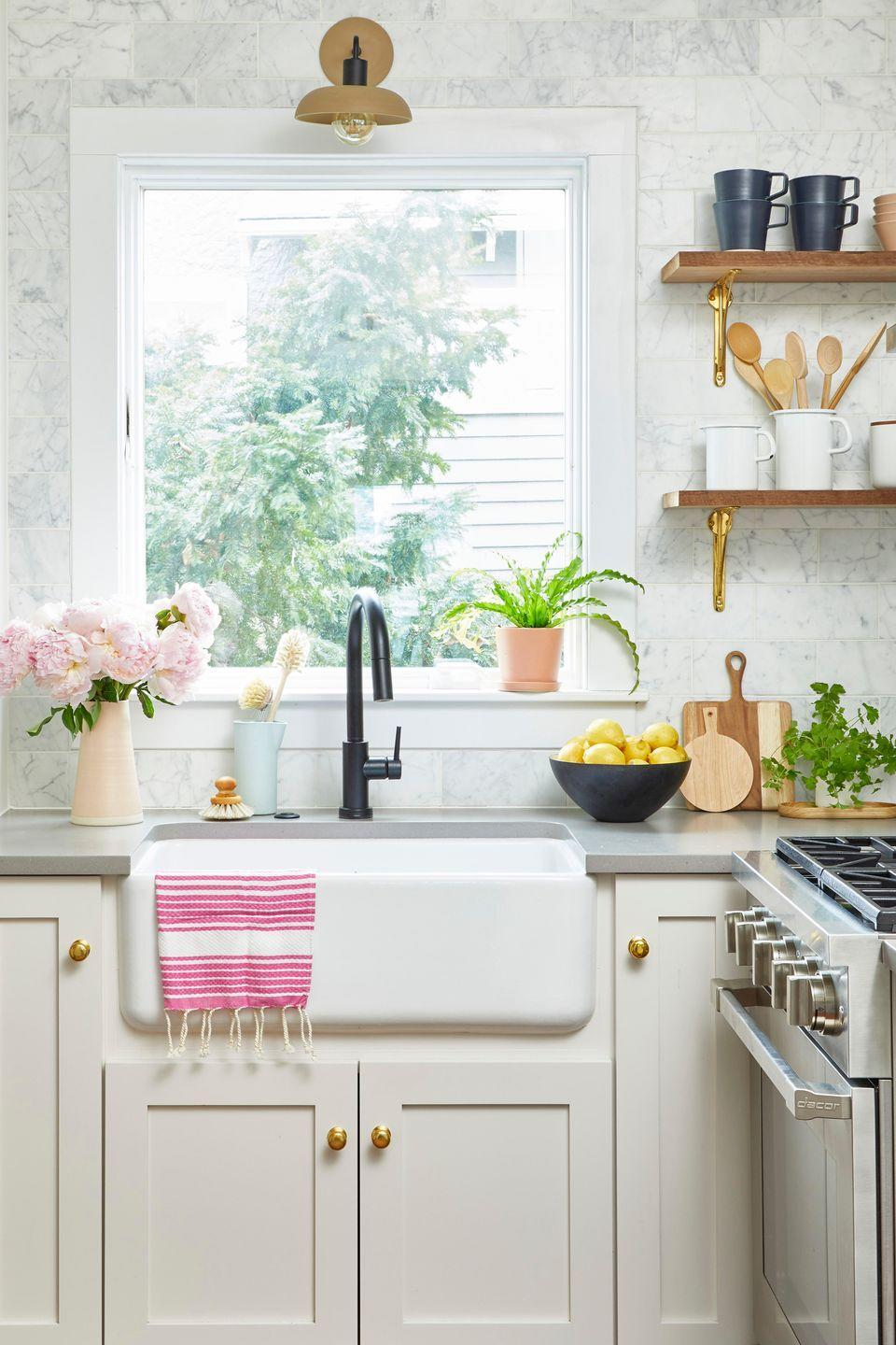 "<p>Unsightly kitchen grime is a mix of dust and grease that builds up over time. Run the exhaust hood over your range every time you cook to keep grease from settling. To de-gunk, use <a href=""http://www.amazon.com/Parker-Bailey-Kitchen-Cabinet-Cream/dp/B000ETQMAO/?tag=syn-yahoo-20&ascsubtag=%5Bartid%7C10063.g.35370825%5Bsrc%7Cyahoo-us"" rel=""nofollow noopener"" target=""_blank"" data-ylk=""slk:Parker & Bailey Kitchen Cabinet Cream"" class=""link rapid-noclick-resp"">Parker & Bailey Kitchen Cabinet Cream</a> because it cuts through dirt and leaves wood moisturized. Do an extra pass around any places that grease collects, like door and drawer pulls. </p><p><a class=""link rapid-noclick-resp"" href=""https://www.amazon.com/Parker-Bailey-Kitchen-Cabinet-Cream/dp/B000ETQMAO?tag=syn-yahoo-20&ascsubtag=%5Bartid%7C10063.g.35370825%5Bsrc%7Cyahoo-us"" rel=""nofollow noopener"" target=""_blank"" data-ylk=""slk:SHOP CABINET CREAM"">SHOP CABINET CREAM</a></p>"
