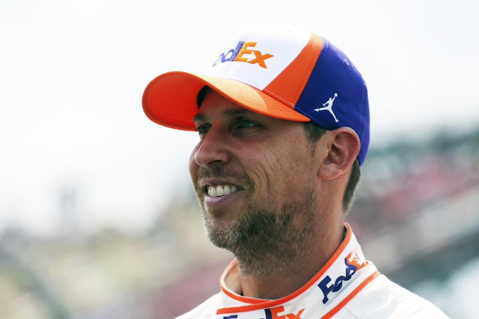 Denny Hamlin stands by his car before a NASCAR Cup Series auto race in Watkins Glen, N.Y., on Sunday, Aug. 8, 2021. (AP Photo/Joshua Bessex)