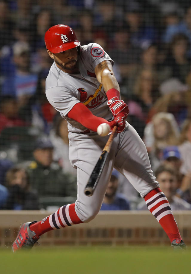 St. Louis Cardinals' Tommy Pham hits a two-run double against the Chicago Cubs during the ninth inning of the second baseball game of a doubleheader Saturday, July 21, 2018, in Chicago. (AP Photo/Jim Young)