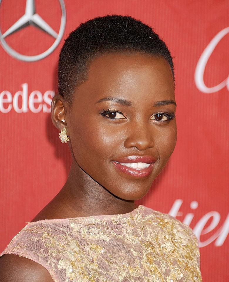 <p>Lupita Nyong'o shows off her naturally textured buzz cut with style and grace at the25th Annual Palm Springs International Film Festival Awards Gala. (Photo: Getty Images) </p>