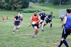 Photo: Jamie Lourenco of Toronto Muddy York RFC/ Toronto Lions RFC plays Flag Mixed Ability Rugby at practice  Photo Credit: Charlotte Coulsen