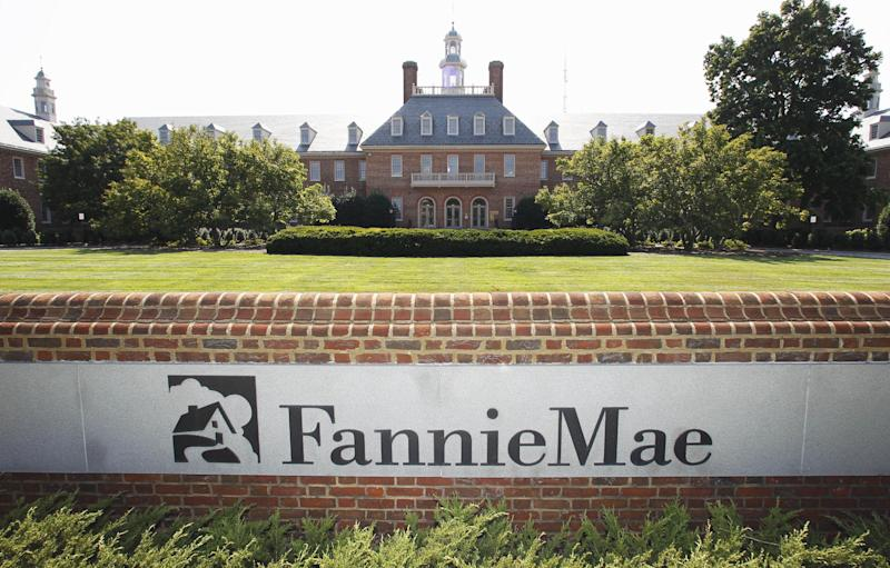 FILE - In this Aug. 8, 2011, photo, the Fannie Mae headquarters is seen in Washington.  Fannie Mae earned $17.2 billion lin 2012, the biggest annual profit in the U.S. mortgage giant's history, helped by a record fourth quarter. The 2012 gain was driven by the housing recovery, which has reduced delinquencies and lifted home prices six years after the bubble burst. (AP Photo/Manuel Balce Ceneta, File)