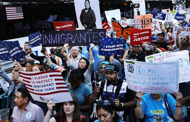 <p>Hundreds of immigration advocates and supporters attend a rally and march to Trump Tower in support of the Deferred Action for Childhood Arrivals program also known as DACA on Aug. 30, 2017, in New York City. Immigrants and advocates across the country are waiting to hear President Trump's decision on whether he will keep DACA, which allows young people who immigrated to the U.S. as children to temporarily escape deportation and receive other benefits, started under President Barack Obama in 2012. (Photo: Spencer Platt/Getty Images) </p>