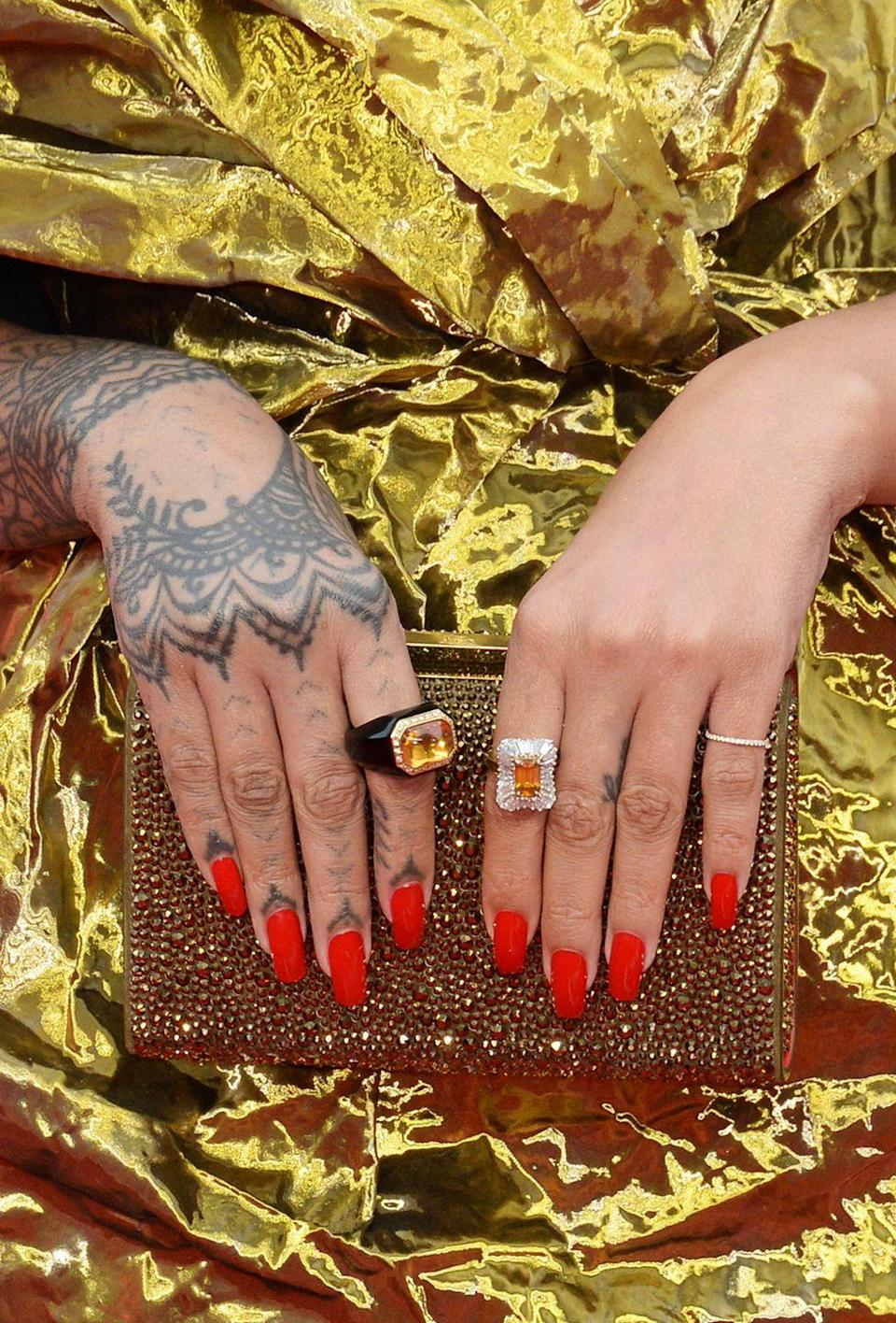 <p>If Riri were a nail color, this badass neon red would be her ~soul shade~. </p>