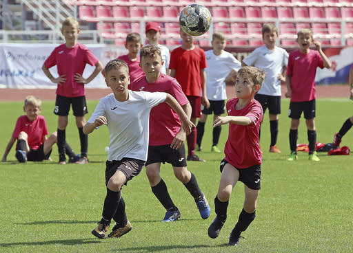 In this photo taken on Thursday, May 17, 2018, boys play during a children soccer tournament at the Start Stadium in Saransk, Russia. The Start Stadium in Saransk may not look like much, but its the jumping-off point for hundreds of young Russians dreams of soccer stardom. (AP Photo)