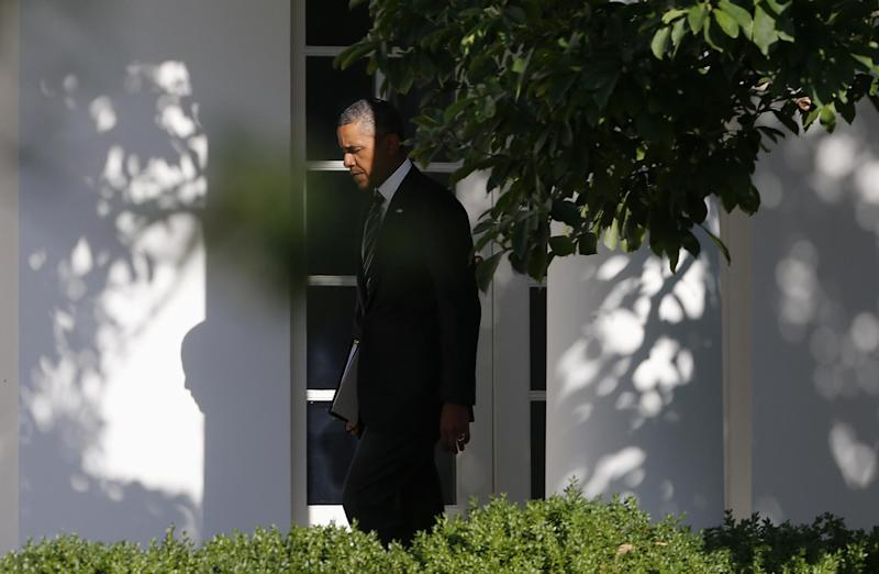 In this photo taken Aug. 22, 2013, President Barack Obama walks along the West Wing colonnade of the White House in Washington before traveling to New York and Pennsylvania. Nearly five years into his presidency, Obama confronts a world far different from what he envisioned when he first took office. U.S. influence is declining in the Middle East as violence and instability rock Arab countries. An ambitious attempt to reset U.S. relations with Russia faltered and failed. Even in Obama-friendly Europe, there's deep skepticism about Washington's government surveillance programs. (AP Photo/Charles Dharapak)