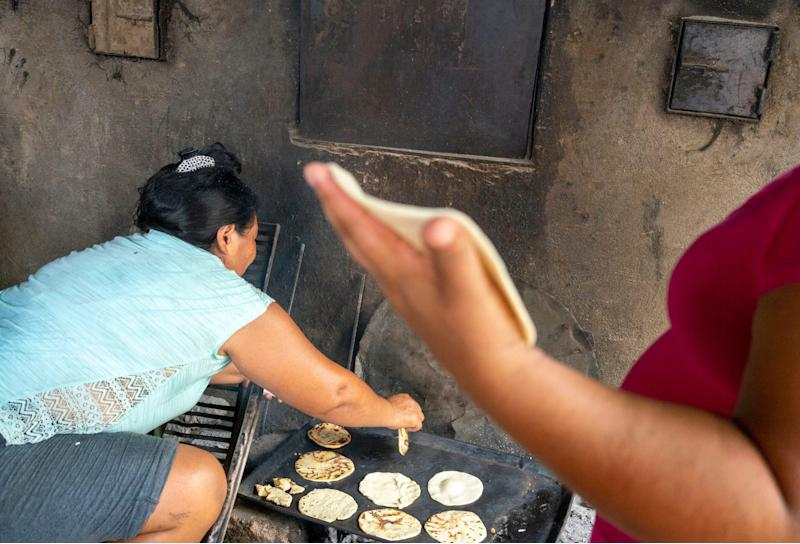 TAPACHULA, Mexico – Central American migrants make tortillas at the Jesus the Good Shepard Shelter for Migrants in Tapachula, Mexico, while they wait for a transit visa to go north toward the United States.