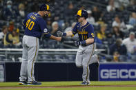 Milwaukee Brewers' Billy McKinney, right, is greeted by third base coach Jason Lane (40) after hitting a home run during the fifth inning of a baseball game against the San Diego Padres, Monday, April 19, 2021, in San Diego. (AP Photo/Gregory Bull)