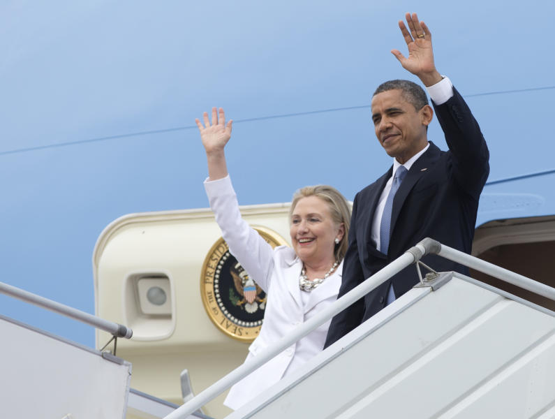 U.S. President Barack Obama and Secretary of State Hillary Rodham Clinton wave as they arrive at Yangon International Airport in Yangon, Myanmar, on Air Force One, Monday, Nov. 19, 2012. This is the first visit to Myanmar by a sitting U.S. president. (AP Photo/Carolyn Kaster)