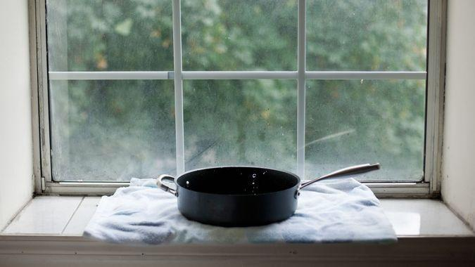 Water dripping from ceiling into pan due to a hurricane; Brooklyn, New York, USA.