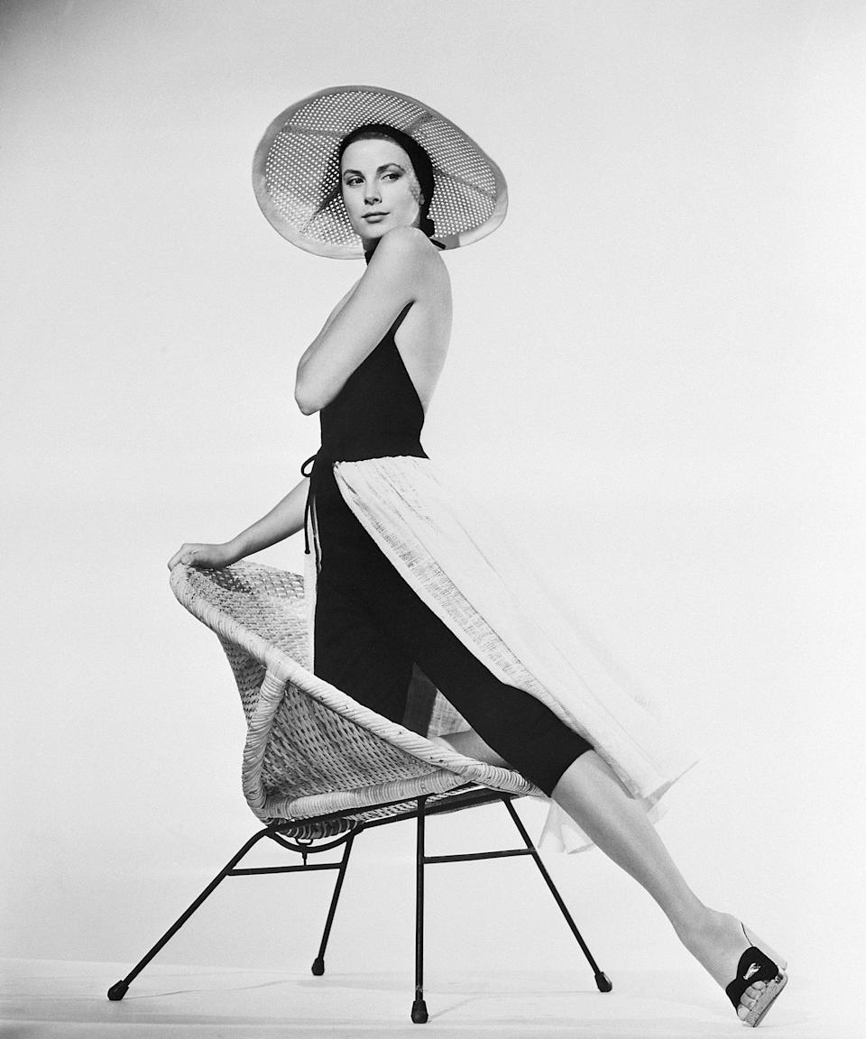 The actress-turned-royal strikes a pose in this 1955 image.