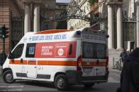 An ambulance is driven past the St. Anna gate, one of the entrances to the Vatican, Friday, March 6, 2020. The Vatican confirmed the walled city-state's first case of the new coronavirus Friday and closed some offices as a precaution while Pope Francis continued recovering from a cold. (AP Photo/Andrew Medichini)