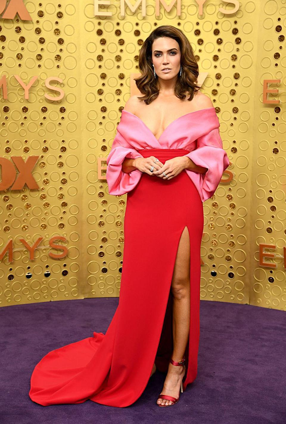 <p>Mandy Moore was just one of many who stepped out in a bold two-tone red and pink gown at the 2019 Emmy Awards. But her Brandon Maxwell was undeniably a hit, with a portrait neckline and body-hugging skirt.</p>